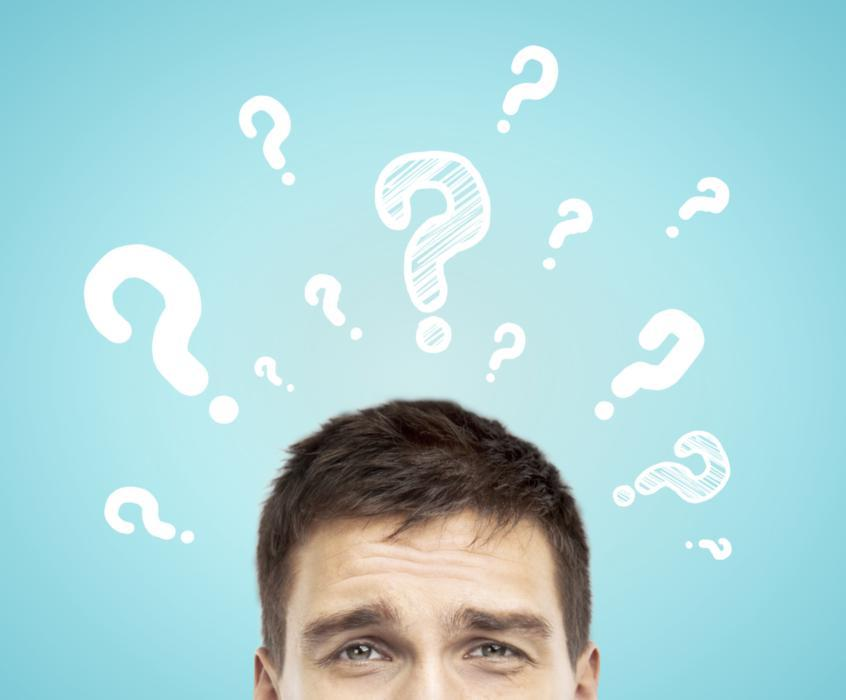 A man with animated question marks above his head | Bonita Springs, FL Dentist