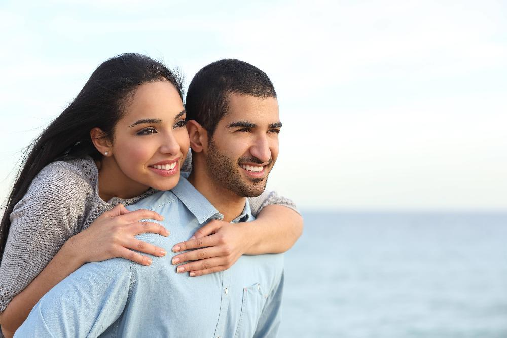 Younger couple on the beach | Dentist in Bonita Springs