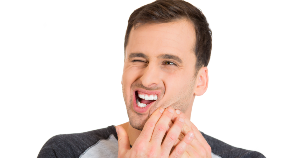 A man holds his jaw | Dental Extractions Bonita Springs, FL