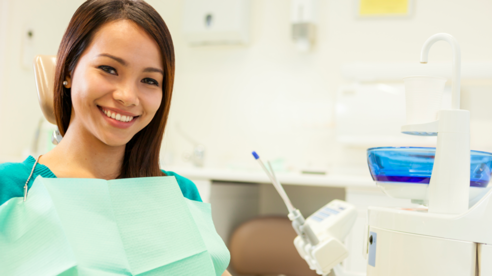 A Patient Smiles In The Dental Chair | Crowns and Bridges Bonita Springs, FL