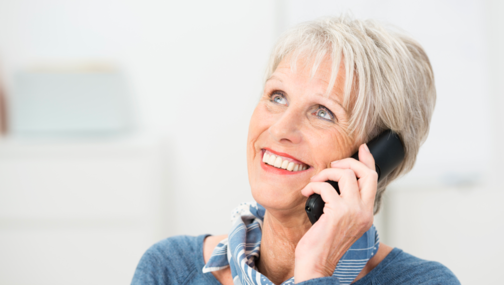 A Woman Smiles While Talking On The Phone | Dentures Bonita Springs, FL