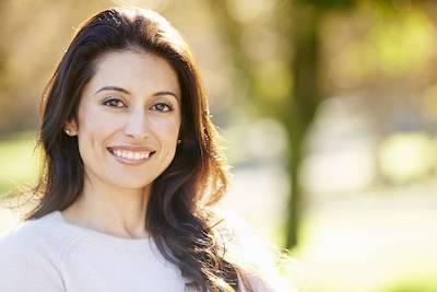 Woman smiling wearing Invisalign in North Naples, FL