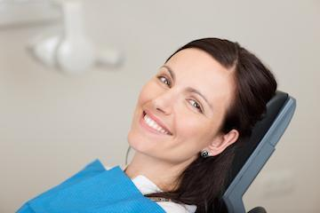 Dental patient smiling during periodontal treatment in 34135
