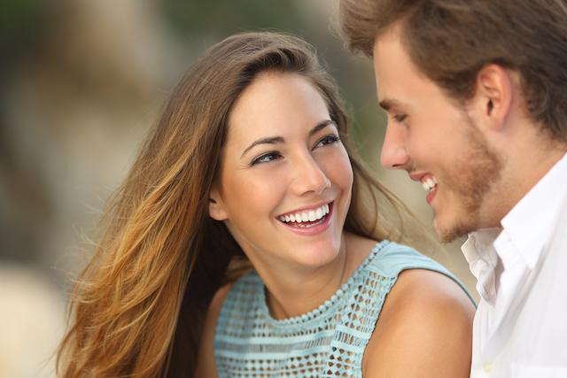 A Woman and Man Smile | Invisalign Bonita Springs FL