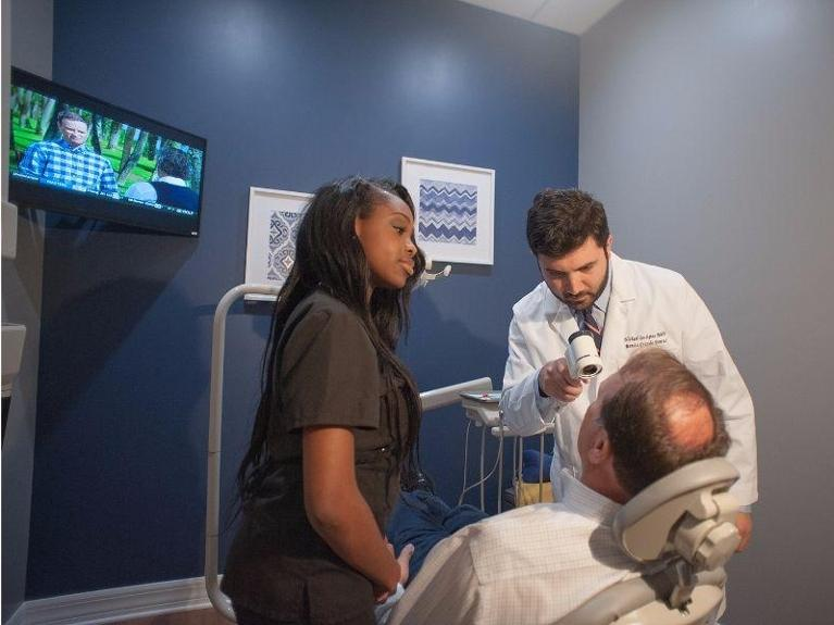 Dr. gostigian and a dental assistant use the VELscope | dentist in bonita springs